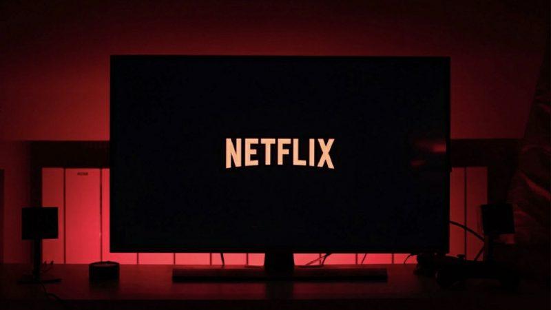 Netflix logo on TV in dark room